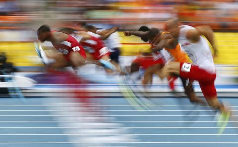 David Oliver of the U.S. (L) clears a hurdle in the men's 110 metres hurdles semi-finals during the IAAF World Athletics Championships at the Luzhniki stadium in Moscow August 12, 2013.