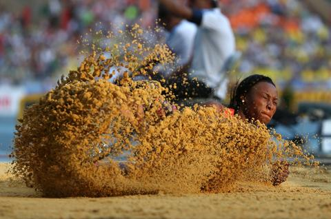 Germany's Sostene Moguenara competes in the women's long jump event at the 2013 IAAF World Championships at the Luzhniki stadium in Moscow on August 10, 2013.