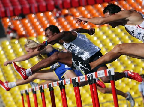Madagascar's Kame Ali (C) races during the men's decathlon 110 metres hurdles event at the 2013 IAAF World Championships at the Luzhniki stadium in Moscow on August 11, 2013.