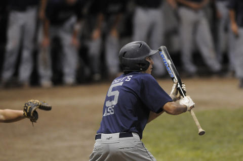 Pinch hitter Augustine Torello, 7, of Branford, hits a suicide squeeze in the bottom of the seventh inning driving in Branford's twelfth run. The run gave ended the game early because of the mercy rule, but because Torello never made it to first base, Worcester argued the call.