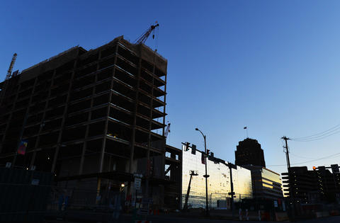 A view from Linden Street of the hockey arena construction site is silhouetted during dusk on an August evening.