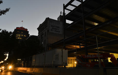 A view from Hamilton Street of the hockey arena construction site during dusk on an August evening.