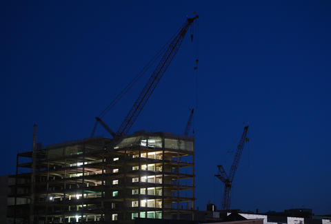 A view from a roof top on Sixth Street of the hockey arena construction site during dusk on an August evening.