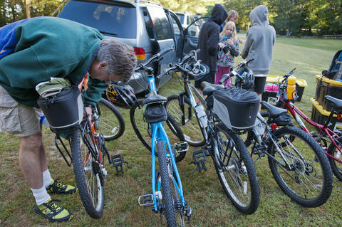 2013.08.15 - Thompson, CT - From the starting point inside Quaddick State Park in Thompson, Scott Young of Monroe, Ct, prepares one of the bikes he and his family will be riding during an 11-day trek through Connecticut to commemorate the centennial of its State Park system.