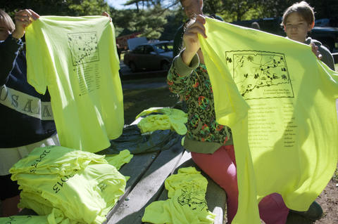 2013.08.15 - Thompson, CT - Katie Young and her daughter Becky, 11, of Orange, Ct, sort through t-shirts they will be wearing during their 11-day ride through the state with about 20 other cyclists to commemorate the centennial of Connecticut's State Park system.