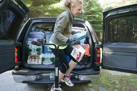 2013.08.15 - Thompson, CT - Diane Joy unloads food from her car in Quaddick State Park to feed breakfast to about twenty cyclists before the start of their 11-day journey through Connecticut to commemorate the centennial of the state's State Parks.