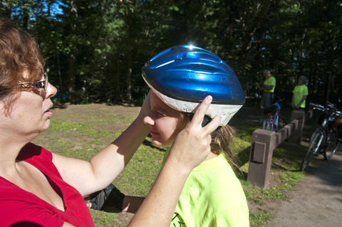 2013.08.15 - Thompson, CT - Mabel Butress (L) adjusts the helmet of her daughter Laura, 12, before the start of their 11-day journey through Connecticut to commemorate the centennial of the state's State Parks.