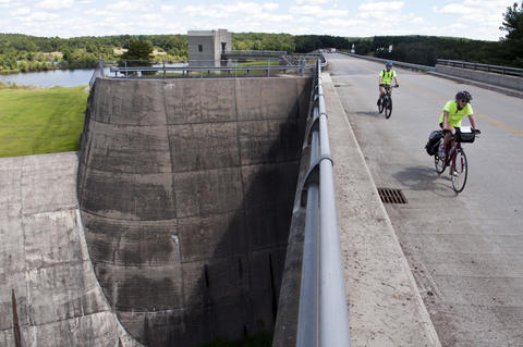 2013.08.15 - Thompson, CT - Cyclists Frank Rauber of Danbury and Joan Samson of Orange cross a section of the West Thompson Dam during the first of an 11-day journey about 20 cyclists will make to commemorate the centennial of Connecticut's State Park system.
