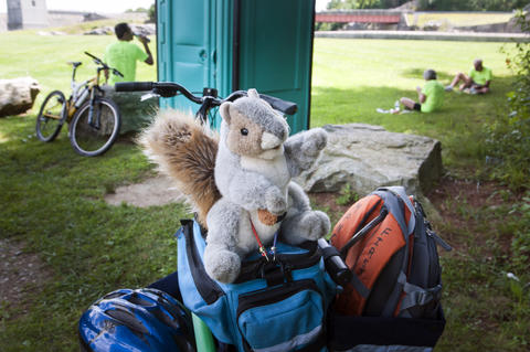 2013.08.15 - Thompson, CT - During a break in riding at the West Thompson dam, a stuffed squirrel rests lashed to the rear of the bike Al Levere is riding along with about 20 other cyclists on an 11-day trek through Connecticut to commemorate the centennial of its State Park system.