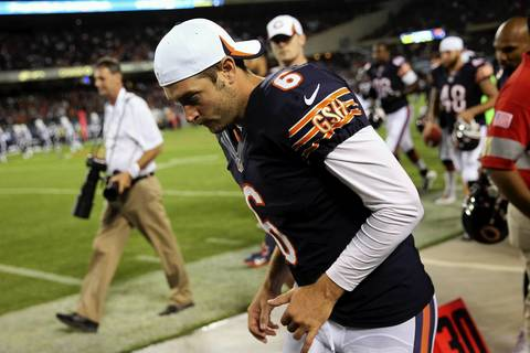 Bears quarterback Jay Cutler runs to the locker room at halftime. The Bears led 20-0.