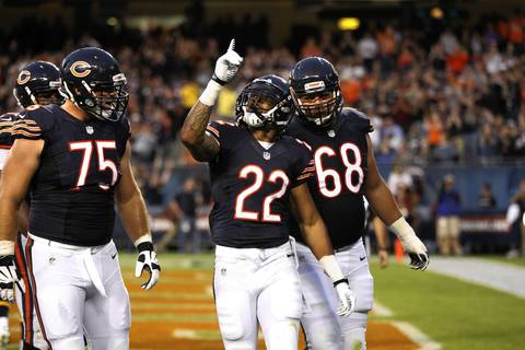 Matt Forte celebrates a first quarter rushing touchdown.