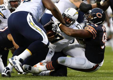 Defensive end Corey Wootton sacks Chargers quarterback Philip Rivers in the first quarter.