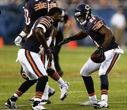 Safety Major Wright (21) celebrates with Devin Hester after Wright recovered a San Diego fumble in the first quarter.
