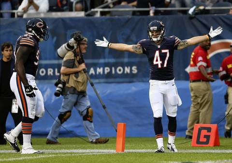 Safety Chris Conte celebrates after intercepting a pass in the first quarter.