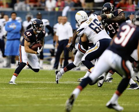 Chris Conte returns an interception in the first quarter.
