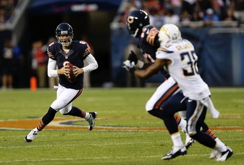 Bears quarterback Jay Cutler rolls out of the pocket during the first quarter.