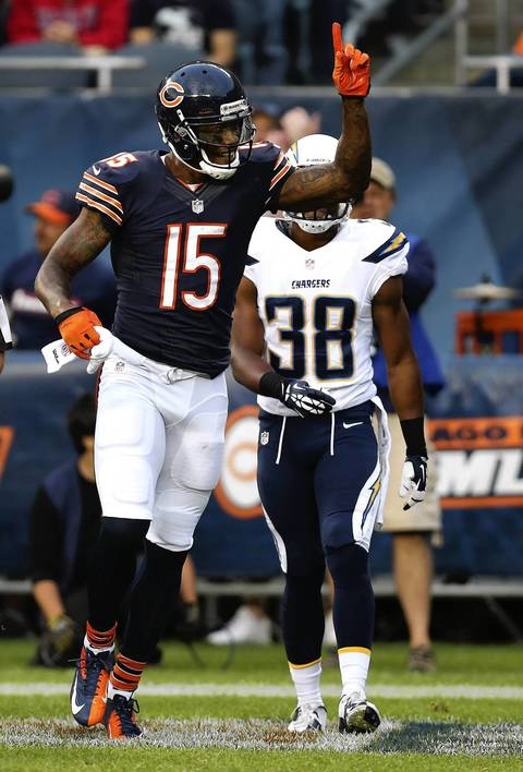 Brandon Marshall celebrates a touchdown catch in the first quarter.