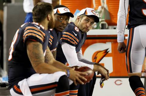 Jay Cutler sits beside wide receiver Brandon Marshall in the 4th quarter.