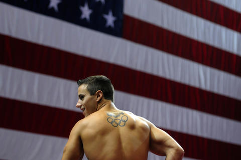 Hartford, Ct 08/14/2013 Jake Dalton, who represented the United States at the 2012 Summer Olympics in London, talks to teammates during a break in his podium training. The 2013 P&G Gymnastics Championship is held at the XL Center in Hartford this week August 15 - 18. The four-day competition serves as USA Gymnastics¿ national championships.