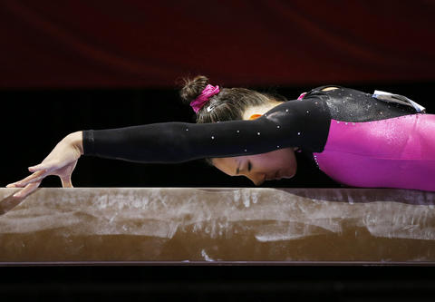 Aug 15, 2013; Hartford, CT, USA; Kyla Ross on the balance beam during the women's P&G Gymnastics Championships.