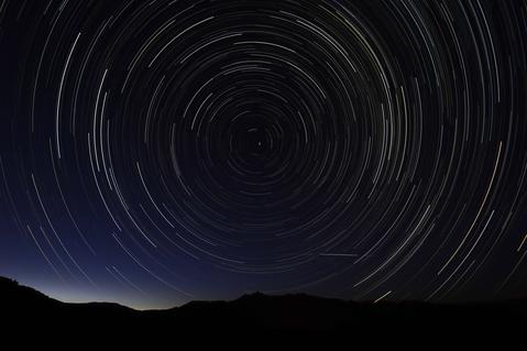 A multiple exposure picture taken in the early hours of August 11, 2013 shows a Perseids meteor shower in the sky, near the municipality of La Hiruela, on the mountains of the Sierra Norte de Madrid.