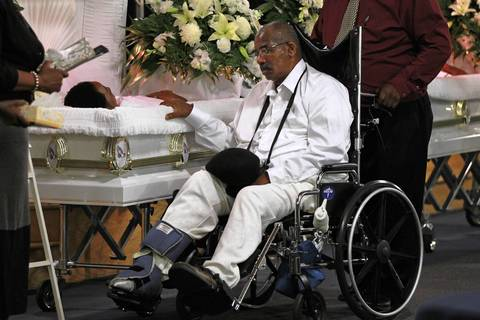 Alvin Black lingers at the casket of his son, LeAndre Cooper, during the funeral for LeAndre and his brother Demetrius at New Beginnings Church on South King Drive in Chicago. The brothers were shot and killed on August 6th in the West Pullman neighborhood.
