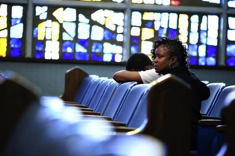 Loved ones weep for Jacobi Herring, who was shot and killed on Aug. 10, during his funeral at Unity Funeral Parlor in Chicago.