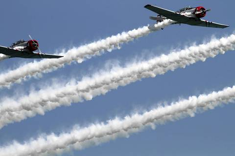 The Geico Skytypers let loose long tails of smoke flying in tight formations at the Chicago Air and Water show.