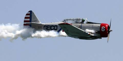 A Geico Skytyper lets loose a long tail of smoke at the Chicago Air and Water show.