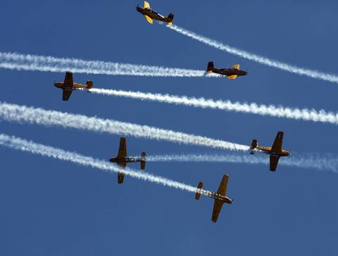 The Lima Lima Flight Team flies in tight formation over North Avenue Beach at the Chicago Air and Water show.
