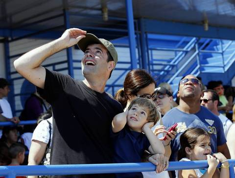 Hernando Testai, of Chicago, and his son, Martin, 4, watch the planes overhead at the Chicago Air and Water show.