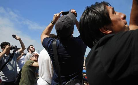 Spectators look to the sky above Lake Michigan during the Chicago Air and Water show.