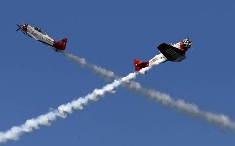 The AeroShell Aerobatic Team performs above Lake Michigan during the Chicago Air and Water Show.