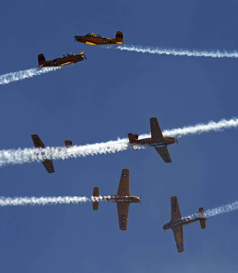 The Lima Lima Flight Team performs above Lake Michigan during the Chicago Air and Water show.
