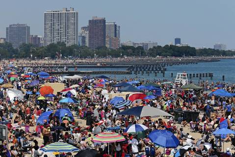 People gather on North Avenue Beach to watch the Chicago Air and Water show.