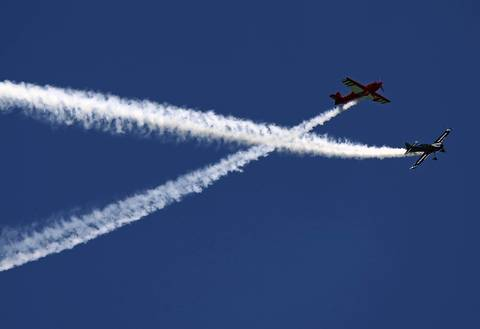 The Firebirds Delta Team performs above Lake Michigan during the Chicago Air and Water show.