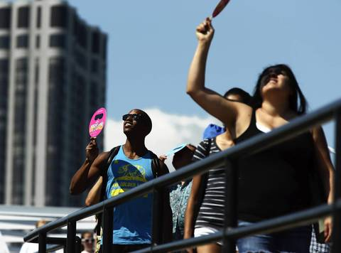 Pedestrians watch planes flying over Lake Michigan during the Chicago Air and Water show.
