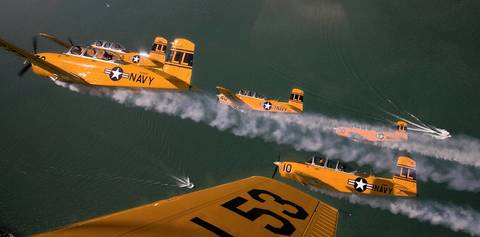 Members of the Lima Lima Flight Team soar in formation over Lake Michigan as Chicago prepares for its annual air and water show.