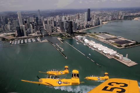 Members of the Lima Lima Flight Team soar in formation over the Chicago skyline as the city prepares for its annual air and water show.