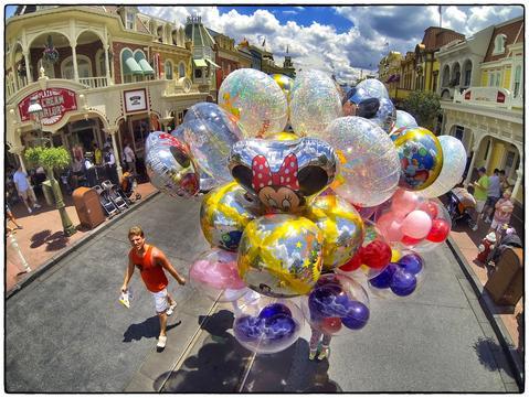 Balloon vendor on a summer afternoon on Main Street USA at the Magic Kingdom, Walt Disney, World, Thursday, August 15, 2013. (Joe Burbank/Orlando Sentinel) B583129894Z.1