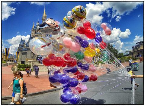 Balloon vendor on a summer afternoon on Main Street USA at the Magic Kingdom, Walt Disney, World, Thursday, August 15, 2013. (Joe Burbank/Orlando Sentinel) B583129894Z.1