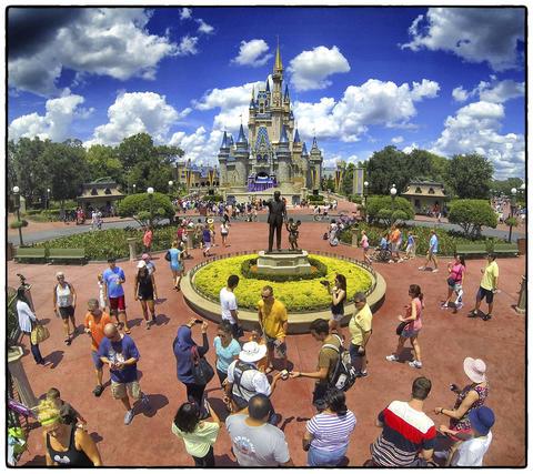 "The 'Partners"" statue of Walt Disney and Mickey Mouse in front of Cinderella Castle, on Main Street USA, at the Magic Kingdom, Walt Disney, World, Thursday, August 15, 2013. (Joe Burbank/Orlando Sentinel) B583129894Z.1"