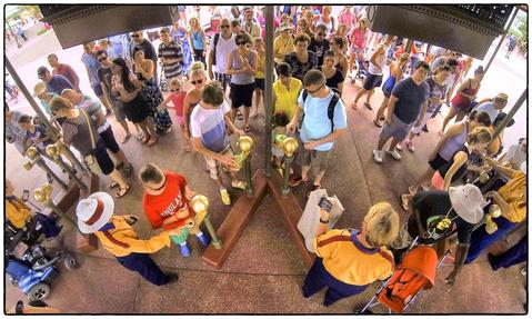Guests arrive at the entrance to the park to check-in using the new MyMagic+ turnstiles, at Main Street USA at the Magic Kingdom, Walt Disney, World, Thursday, August 15, 2013. (Joe Burbank/Orlando Sentinel) B583129894Z.1