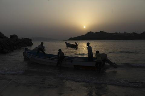 Fishermen are seen with their boats, at a harbour in the southern city of Aden, situated at the mouth of the Red Sea, August 22, 2013.