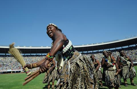 Dancers perform during the inauguration and swearing-in ceremony of the Zimbabwean president on August 22, 2013 at the 60,000-seater sports stadium in Harare. Veteran Zimbabwean President Robert Mugabe was sworn in as Zimbabwe's president for another five-year term before a stadium packed with tens of thousands of jubilant supporters.