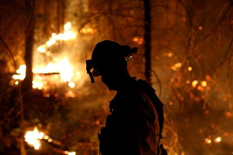 A firefighter from Cosumnes Fire Department monitors a back fire while battling the Rim Fire on August 22, 2013 in Groveland, California. The Rim Fire continues to burn out of control and threatens 2,500 homes outside of Yosemite National Park. Over 1,000 firefighters are battling the blaze that was reduced to only 2 percent containment after it nearly tripled in size overnight.