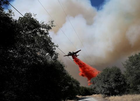 An air tanker drops fire retardant on a ridge ahead of the advancing Rim Fire on August 22, 2013 in Groveland, California. The Rim Fire continues to burn out of control and threatens 2,500 homes outside of Yosemite National Park. Over 1,000 firefighters are battling the blaze that was reduced to only 2 percent containment after it nearly tripled in size overnight.