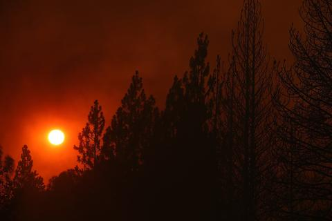 GROVELAND, CA - AUGUST 21:  The sun sets through heavy smoke from the Rim Fire on August 21, 2013 in Groveland, California. The Rim Fire continues to burn out of control and threatens 2,500 homes outside of Yosemite National Park. Over 400 firefighters are battling the blaze that is only 5 percent contained.  (Photo by Justin Sullivan/Getty Images)