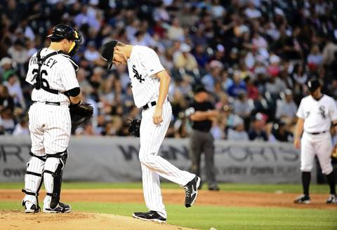 Sox starting pitcher Chris Sale reacts after giving up his second home run of the second inning.