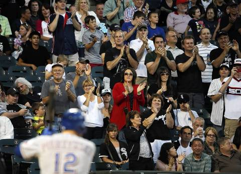 Sox fans acknowledge Texas Rangers catcher A.J. Pierzynski as he comes to bat in the second inning.